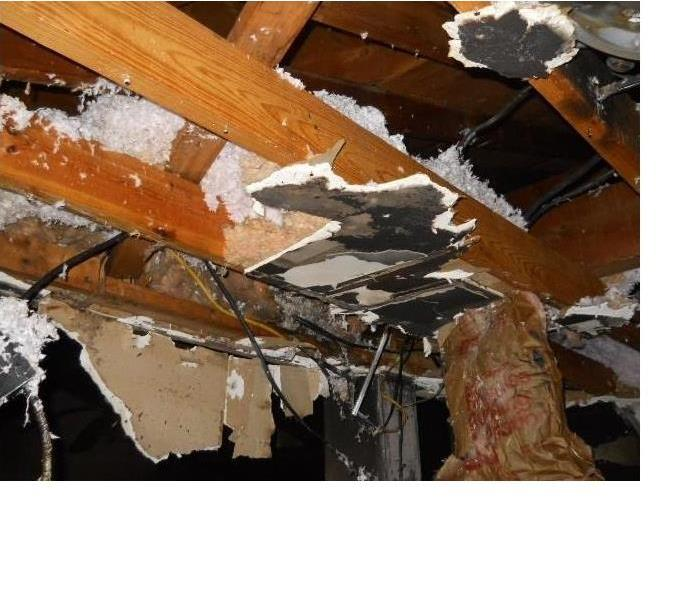hanging ceiling debris and wiring leading to an attic